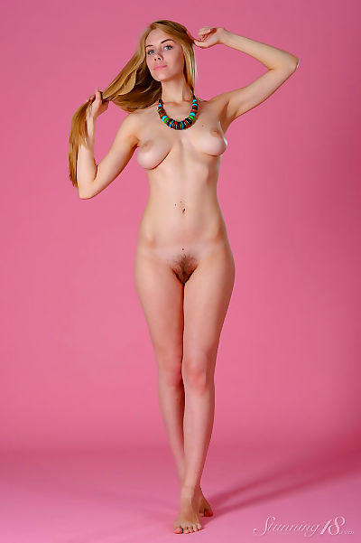 Nude young girl with long..